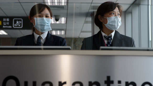 PHOTO: Taiwans Center for Disease Control staff stand at the entrance of Sungshan Airport in Taipei, April 4, 2013.