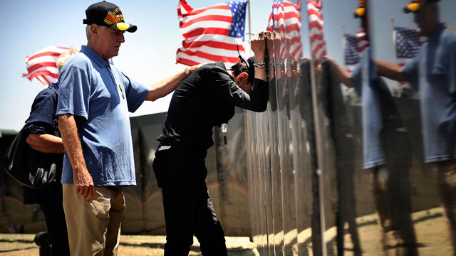 PHOTO: Vietnam Veteran Harold Evans stands with Martin Omafray at the Wall that Heals at Iron Horse Park at Fort Carson in Colorado Springs June 10, 2011.
