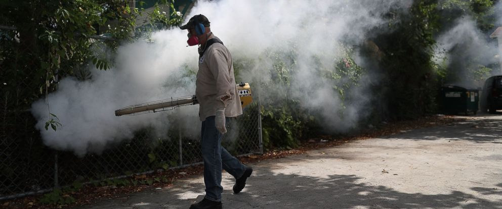 PHOTO: Carlos Varas, a Miami-Dade County mosquito control inspector sprays pesticide to kill mosquitoes in the Wynwood neighborhood on Aug. 2, 2016 in Miami.