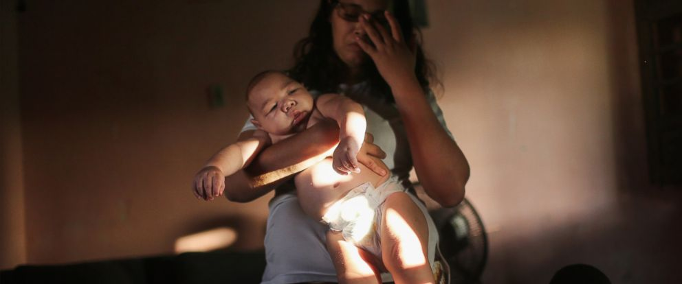 PHOTO: Mylene Helena Ferreira holds her son David Henrique, 5 months, who has microcephaly, on Jan. 25, 2016 in Recife, Brazil.