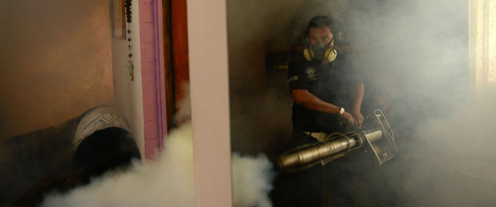 PHOTO: A Health Ministry employee fumigates a home against the Aedes aegypti mosquito to prevent the spread of the Zika virus in Soyapango, six km east of San Salvador, Jan. 21, 2016.