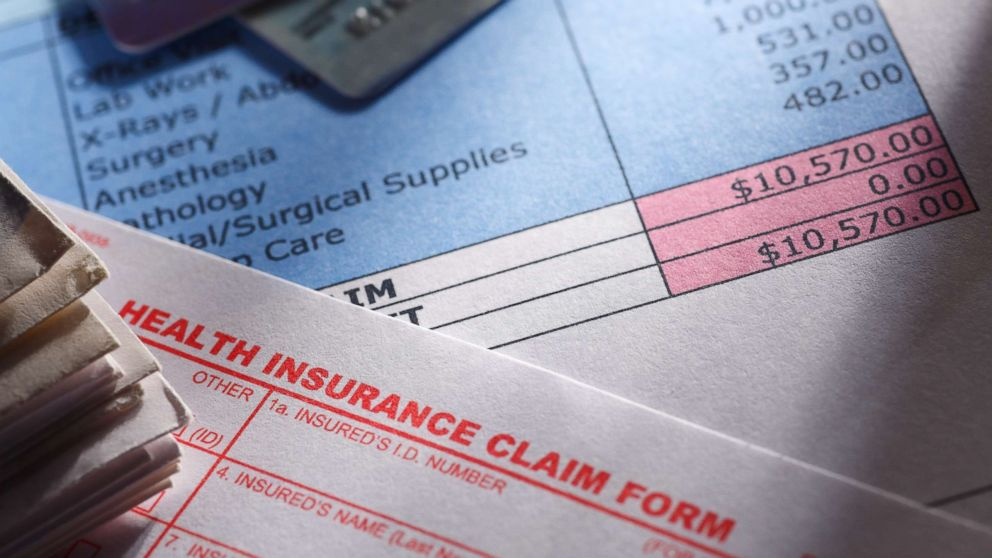 A health insurance claim form is picture next to a hospital bill in an undated stock photo.