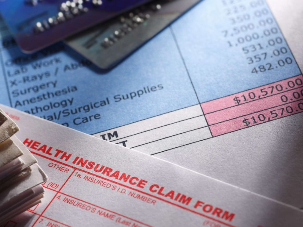 PHOTO: A health insurance claim form is picture next to a hospital bill in an undated stock photo.