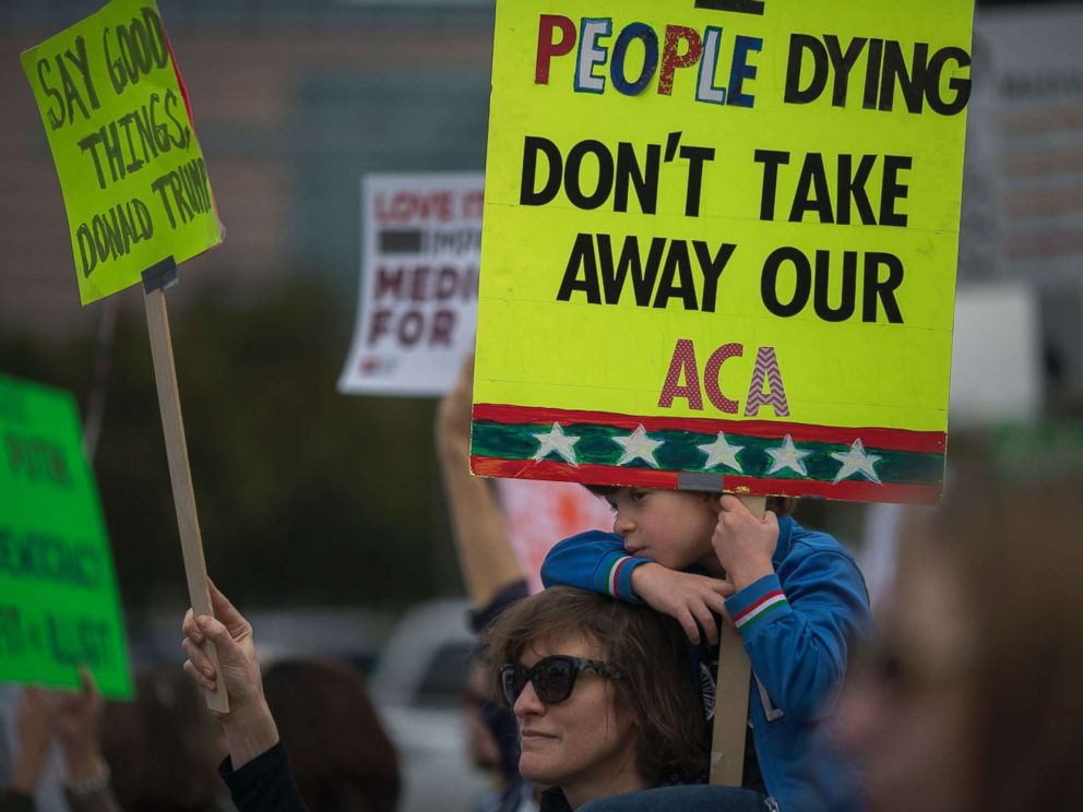 PHOTO: People protest Trump administration policies that threaten the Affordable Care Act, Medicare and Medicaid, near the Wilshire Federal Building, Jan. 25, 2017, in Los Angeles.