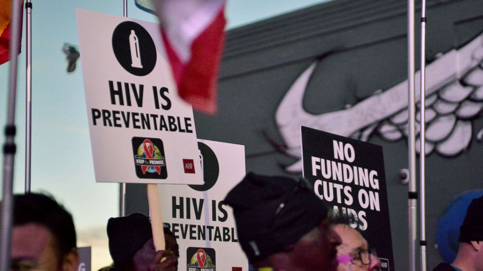 A view of signs at AIDS Healthcare Foundations Keep the Promise March in Hollywood, Calif., Nov. 30, 2016.