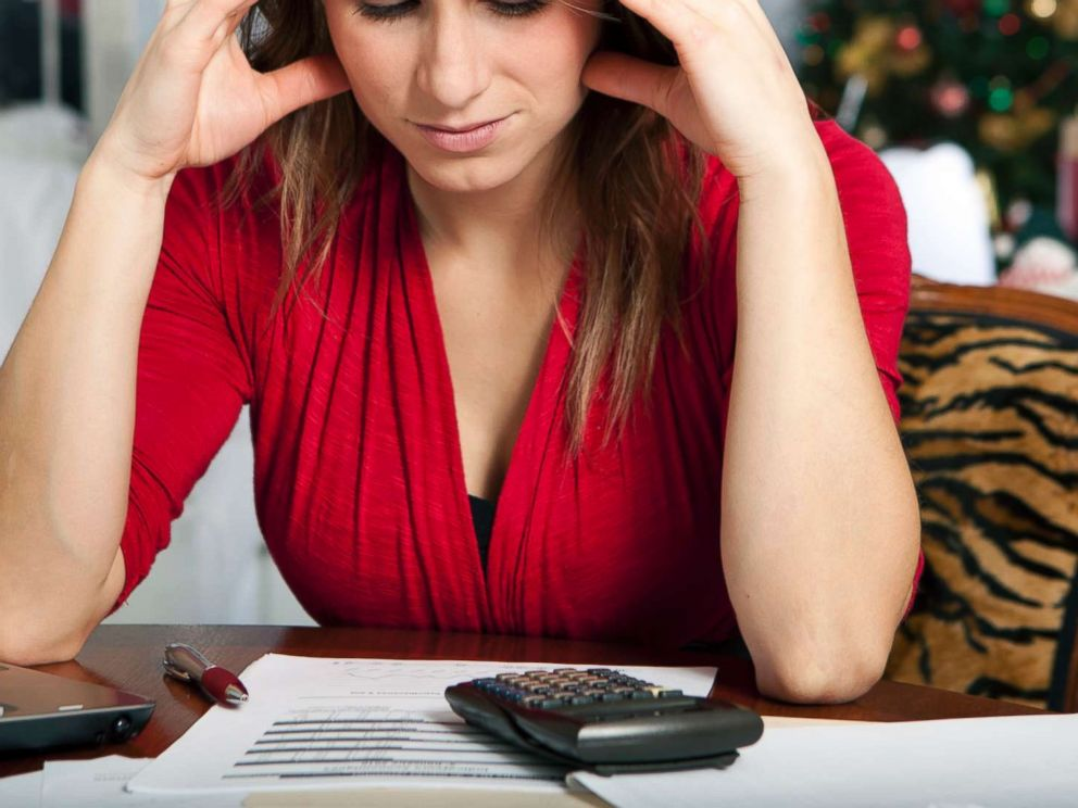 PHOTO: This stock photo depicts a woman who is stressed during the holiday season.