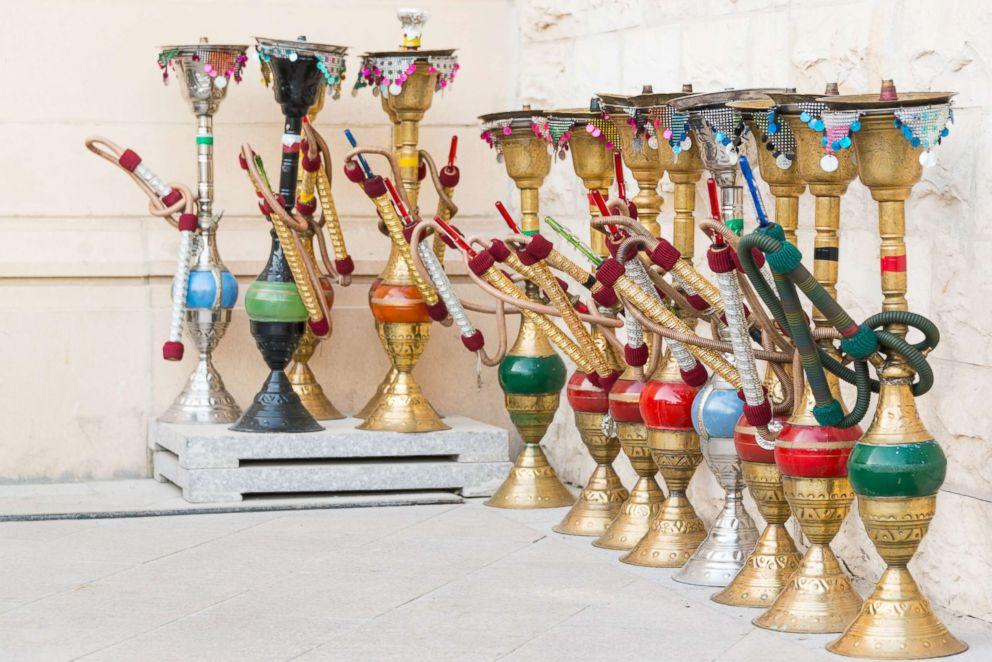PHOTO: Hookahs on Doha pedestrian street near cafe in Qatar.