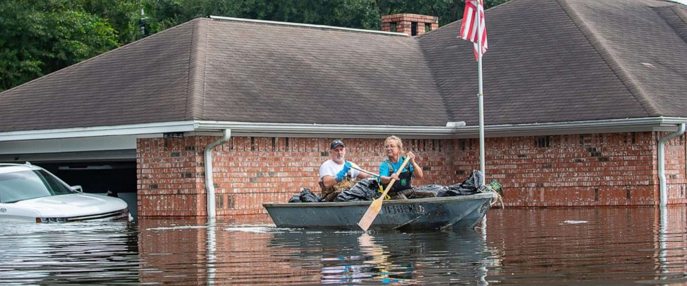 PHOTO: Jason and Susie Horn gather belongings from their home as water continues to rise along Interstate I-10 in Vidor, Texas, Sept. 20, 2019.