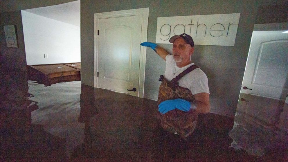 PHOTO: Jason Horn points to the level that his home was flooded by Harvey as water continues to rise along Interstate I-10 in Vidor, Texas, Sept. 20, 2019.