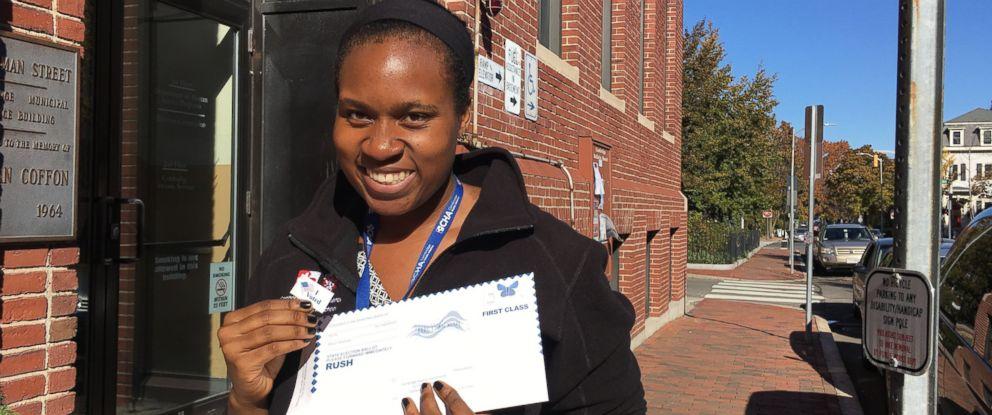 PHOTO: Doctor Jennifer Okwerekwu of Cambridge Hospital in Massachusetts holds an absentee ballot on Nov. 8, 2016.