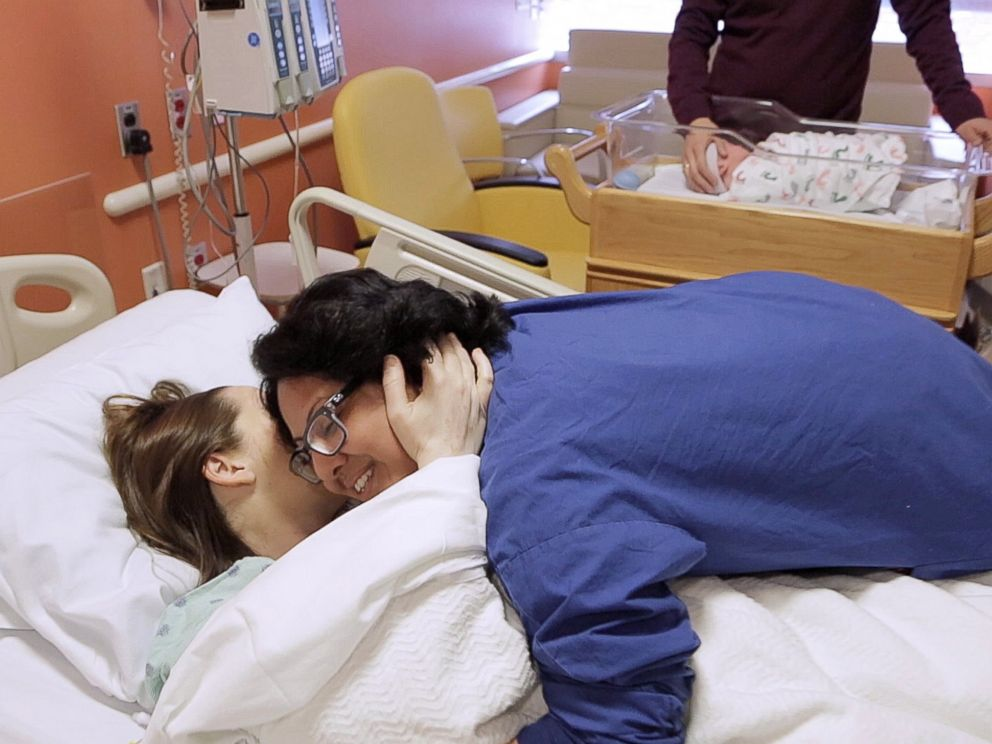 Naomi hugs patient Becky after the joyous and successful delivery of baby Felix.