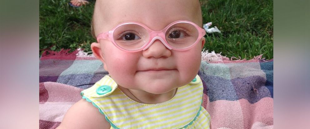 PHOTO: Piper Verdusco, 11 months, smiles while wearing her pink glasses.
