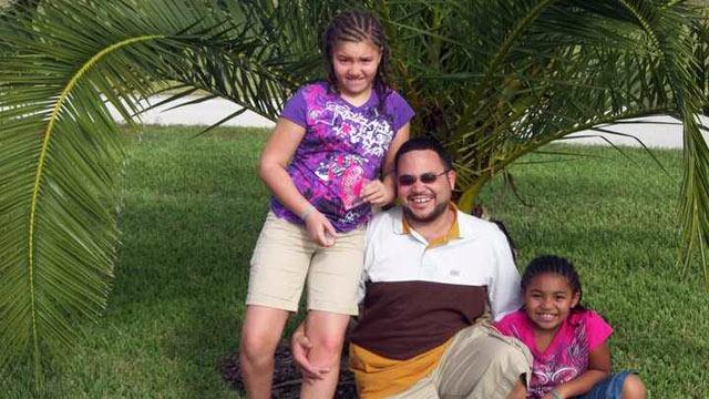 PHOTO: Reynard Zweifel of Kansas City, Mo., with his daughters Amaya, 11, and Leigha, 8.