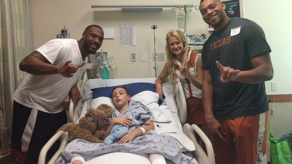 Texas Longhorn football players and cheerleader visit Alex Hermann, while he being treated for a lightning strike.