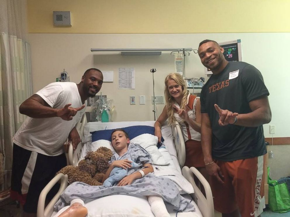 PHOTO: Texas Longhorn football players and cheerleader visit Alex Hermann, while he being treated for a lightning strike.