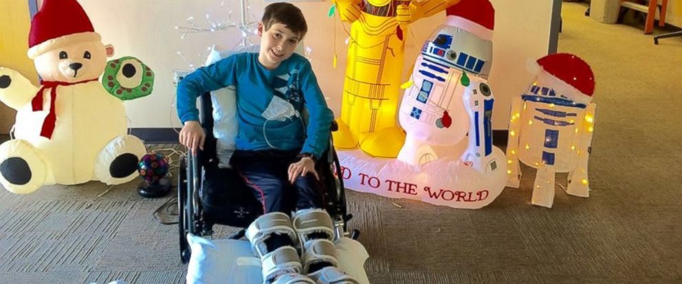 PHOTO: Alex Hermann in front of holiday decorations at Dell Childrens Medical Center of Central Texas before being released from the hospital.