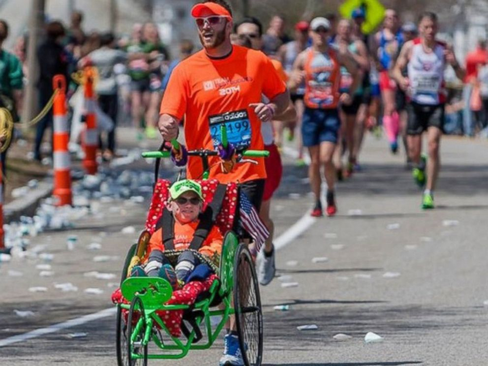 PHOTO: Alosha OBrien, 30, will participate in the Boston Marathon as Craig Welton pushes him in a wheelchair designed by Team Hoyt.