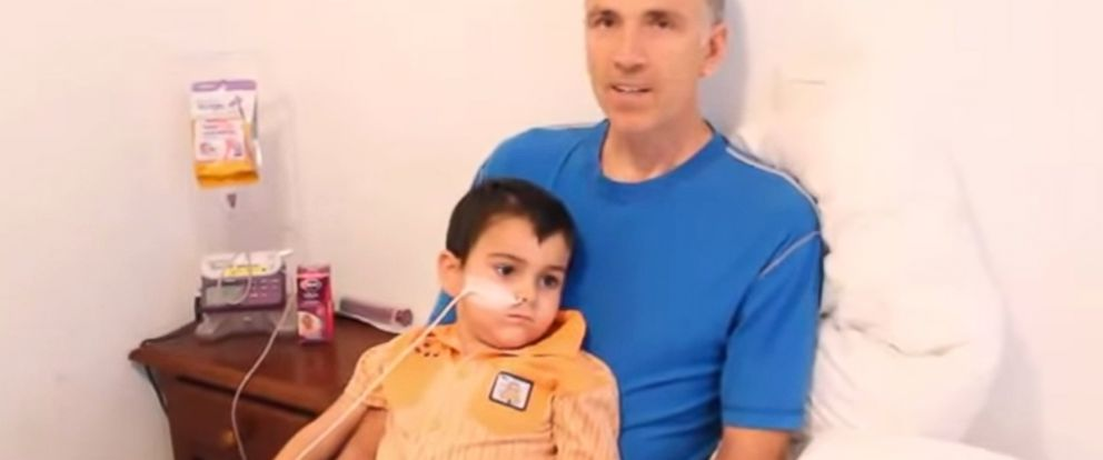 PHOTO: Brett King holds his son Ashya, 5, in a hotel room in Spain. The King family took Ashya from the British hospital where he was being treated to seek a treatment they say his doctors refused to provide: proton beam therapy.