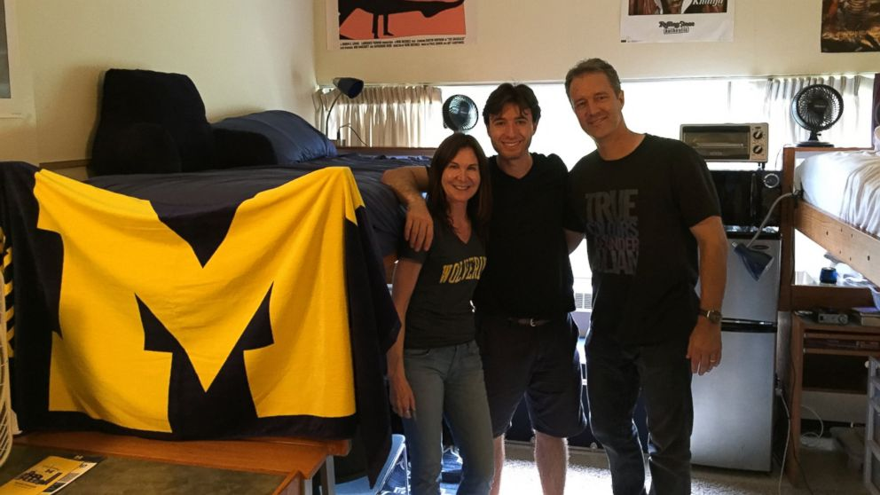 Jake Exkorn poses with his parents in his dorm room at the University of Michigan.
