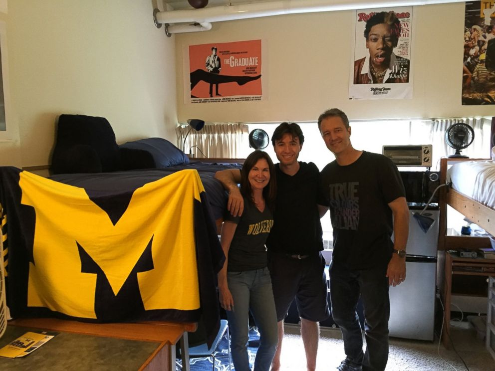PHOTO: Jake Exkorn poses with his parents in his dorm room at the University of Michigan.