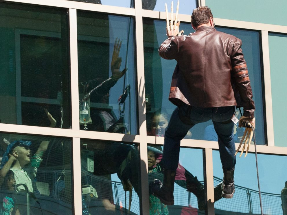 PHOTO: A man dressed as Wolverine from The X-Men rappels from the roof of the Dell Childrens Medical Center in Austin, Texas as part of Superhero Day on April 30, 2015.
