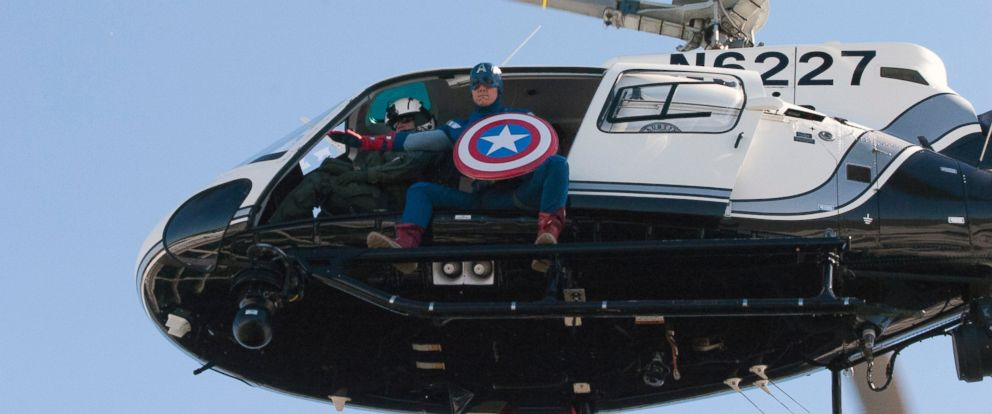 PHOTO: A man dressed as Captain America flies in a police helicopter near the Dell Childrens Medical Center in Austin, Texas as part of Superhero Day on April 30, 2015.