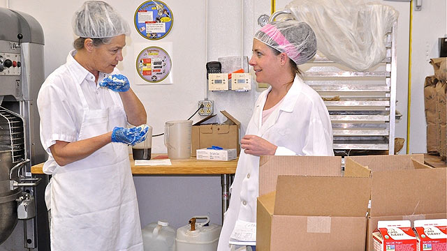 PHOTO:Whole Foods employee Janet Redding and cookbook author Jules Shepard.