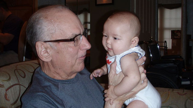PHOTO: Grant Feusner holds his granddaughter, Jade.