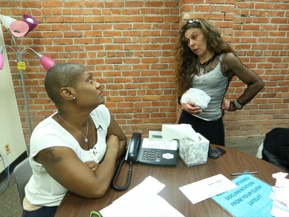 PHOTO: With drug dealers on nearly every corner, Najja Morris keeps a watchful eye on Turina James.