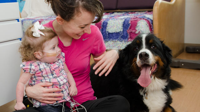 PHOTO: Madison Fleaks at the hospital with her mother, Tabitha Fleaks, and her beloved dog, Kodiak.