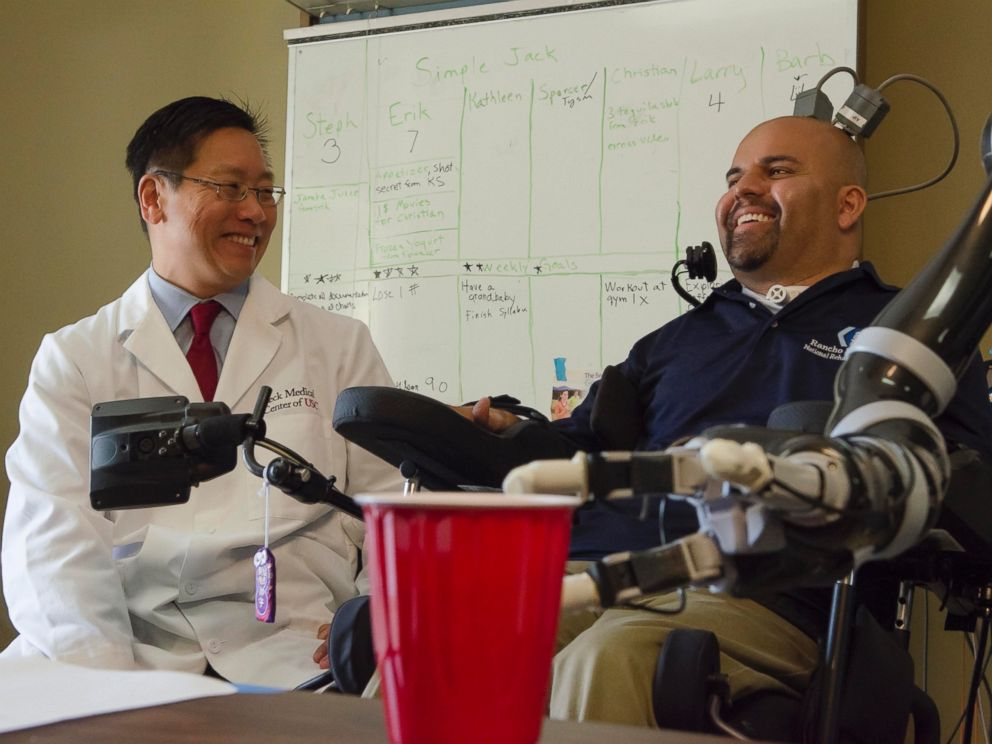 PHOTO: Dr. Charles Y. Liu, professor of neurological surgery, neurology, and biomedical engineering at USC, shares a laugh with patient Erik Sorto.