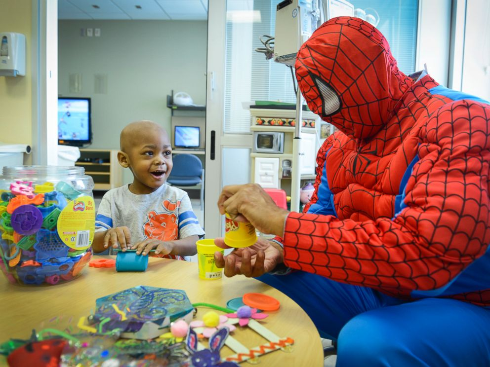 Nasir Lester, 3, and Spiderman play with Play Doh.