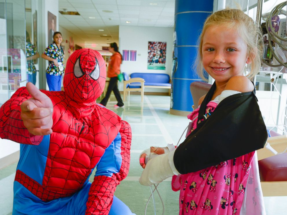 Children went to the hospitals playroom to visit with Spiderman.