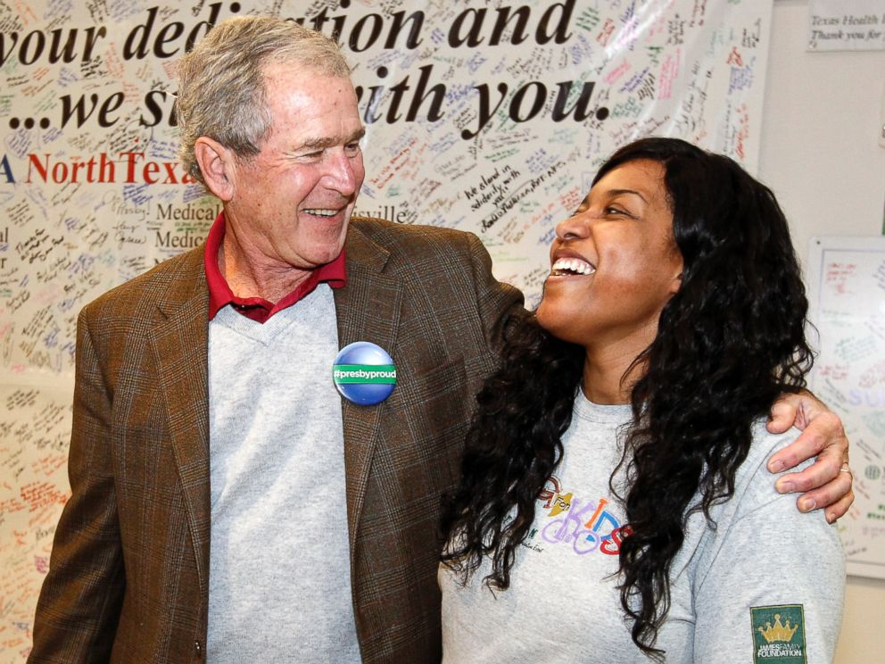 PHOTO: Former President George W. Bush walks into Texas Health Presbyterian Hospital Dallas on Nov. 7, 2014, where he visited with caregivers.