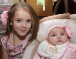 PHOTO: FrankieElizabeth Staiti sits with with her 14-week-old sister Devin Elizabeth Wagner in this undated handout photo.