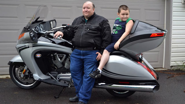 "PHOTO: Stay-at-home dad Wayne Moyer, shown with son Matt, says his bike is his ""manly escape."""
