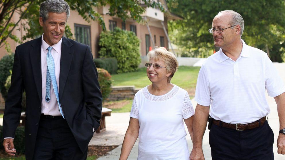 Dr. Richard Besser walks with Ebola survivor Nancy Writebol and her husband, David.