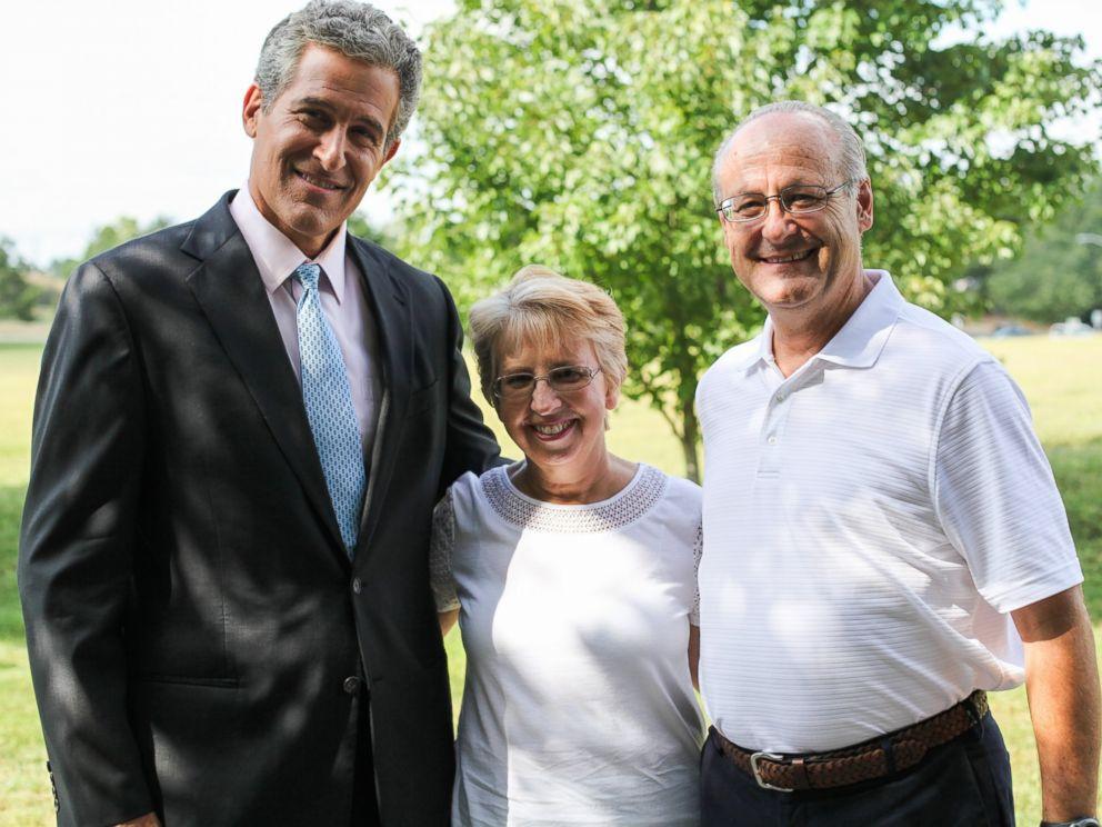 PHOTO: Dr. Richard Besser, left, is pictured with Ebola survivor Nancy Writebol and her husband, David.
