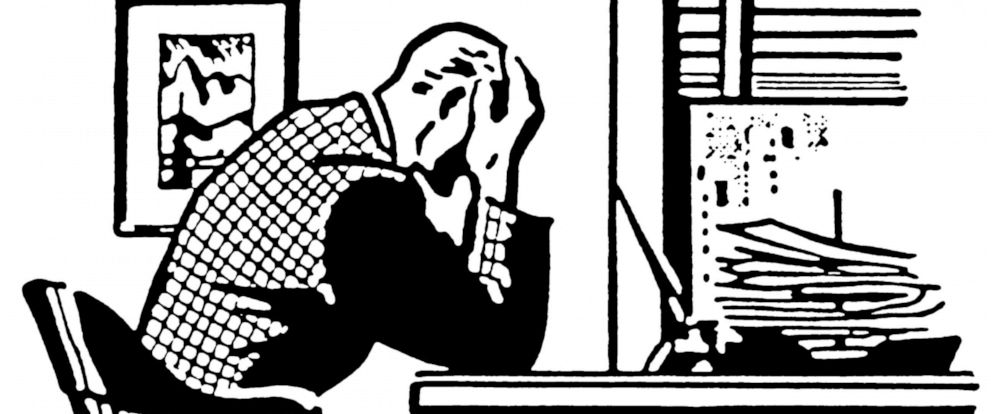 PHOTO: Illustration of a man at his desk with his head in his hands.