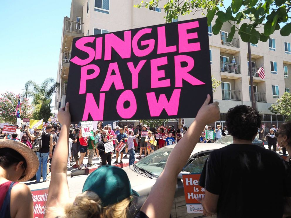 PHOTO: People rally in favor of single-payer healthcare for all Californians outside the office of California Assembly Speaker Anthony Rendon, June 27, 2017, in South Gate, Calif.