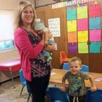 Jessie Sampson poses with her older son, Gram, and infant son Liam.
