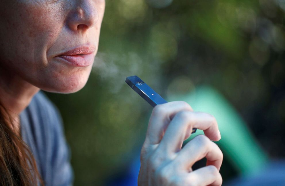 PHOTO: A woman smokes a Juul e-cigarette in this Sept. 16, 2018, photo.