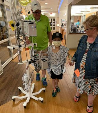 PHOTO: Brayden Auten walks with a family member around the hospital. He recieved his liver transplant from a nurse named Cami Loritz who heard of his story.