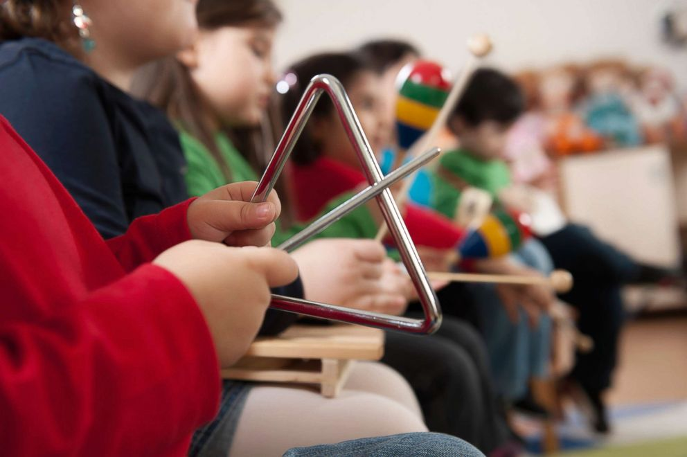 PHOTO: Kindergarten students using musical instruments seen this undated stock photo.