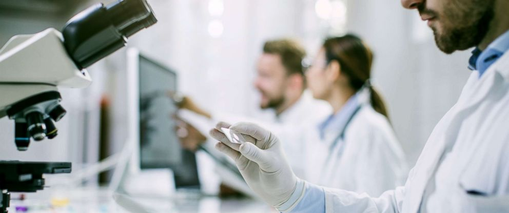 PHOTO: A scientist looks at a slide in this stock photo.
