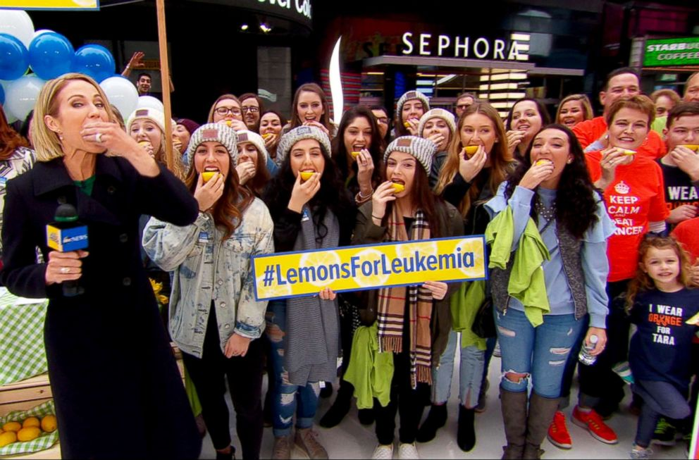 PHOTO: People outside the Good Morning America studio in Times Square take part in the Lemons for Leukemia Challenge, a social media campaign to raise awareness about bone marrow donation