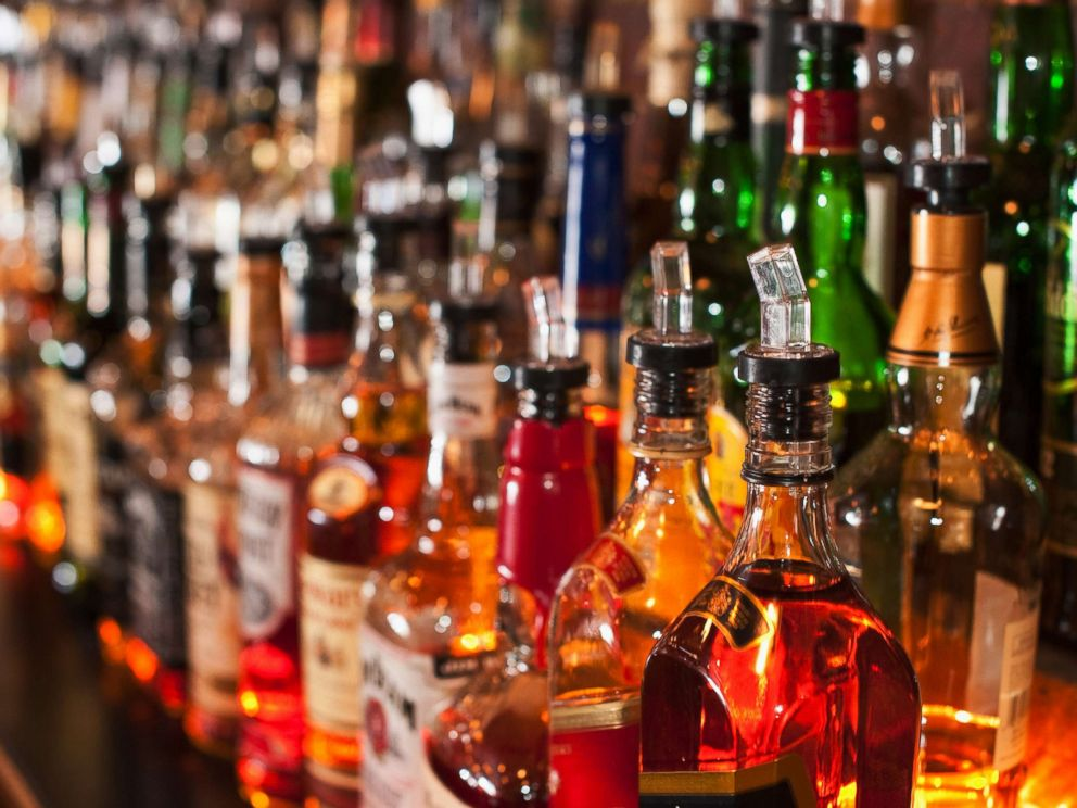 Bottles of liquor sit on a bar in an undated stock image