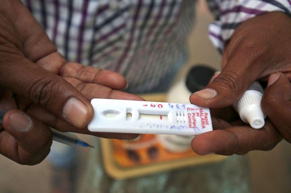 PHOTO: A health worker shows a malaria rapid test kit after collecting blood sample from a resident during a drive to prevent the spread of mosquito-borne diseases in Ahmedabad, India, Oct. 26, 2018.