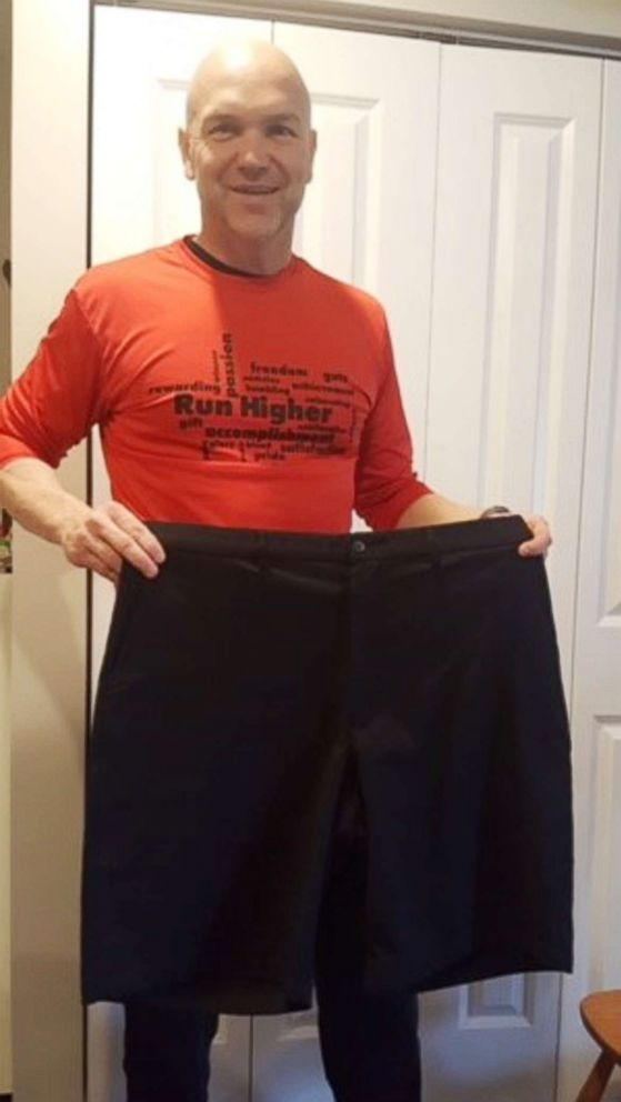 PHOTO: Andy Bell, 45, poses with shorts he wore before his 100-pound weight loss.