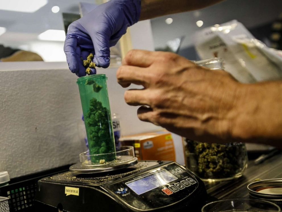 PHOTO: An employee dispenses a customers order at a Medical Marijuana facility, in Santa Ana, Calif., Jan. 1, 2018.